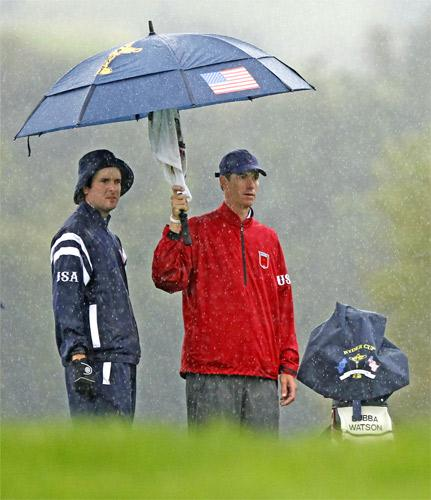Bubba Watson (left), of the US team, and his caddie Ted Scott enjoy the Welsh weather during a practice round at Celtic Manor yesterday
