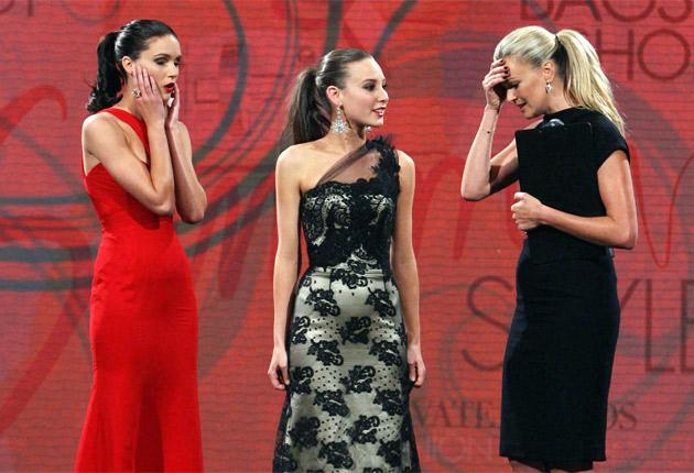 Sarah Murdoch, right, is distraught after wrongly telling Kelsey Martinovich she had beaten Amanda Ware, left