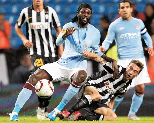 Marchisio of Juventus challenges Manchester City's Emmanuel Adebayor for the ball at Eastlands last night