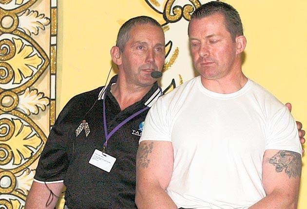 Peter Boatman, left, about to demonstrate a Taser on DC Joe Holness of Kent Police