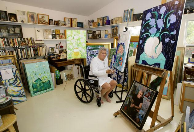 Tony Curtis in his studio last year with examples of his artistic legacy