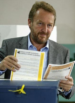 Presidential candidate Bakir Izetbegovic casting his vote; elections will select five presidents and 700 MPs
