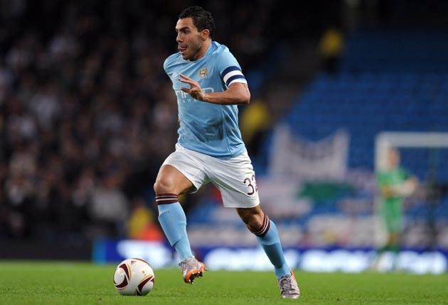 Carlos Tevez (pictured) and Roberto Mancini have a difficult relationship at Manchester City