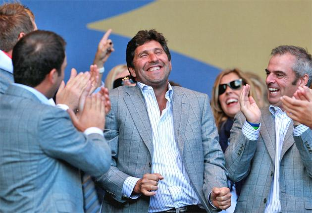Jose Maria Olazabal (centre) enjoys the Ryder Cup win as a possible rival for the captaincy, Paul McGinley, looks on