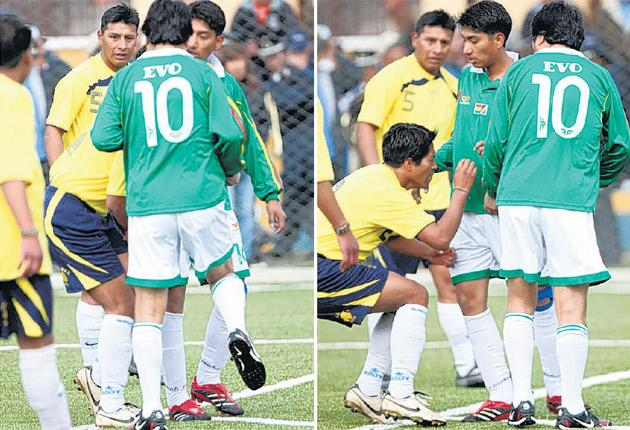 The Movement without Fear player Daniel Cartagena collapses in agony after President Evo Morales appears to knee him