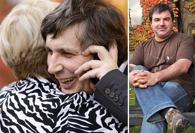 Professor Andre Geim, left, is congratulated by a wellwisher outside Manchester University after being awarded the Nobel Prize for Physics along with Dr Konstantin Novoselov, right