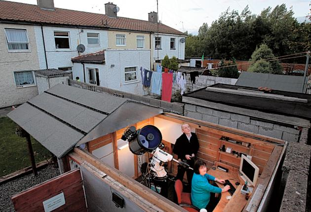 Dave Grennan and his wife Carol in their shed-cum-observatory, where the discovery of Supernova 2010IK was made on 17th September
