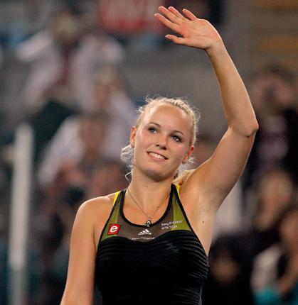 Caroline Wozniacki  acknowledges the crowd after her win over Sara Errani during day six of the 2010 China Open