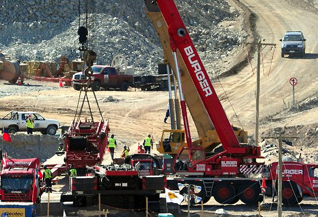 The crane that will pull out the capsules with the miners is being assembled at the San Jose mine, near the city of Copiapo, in the arid Atacama desert