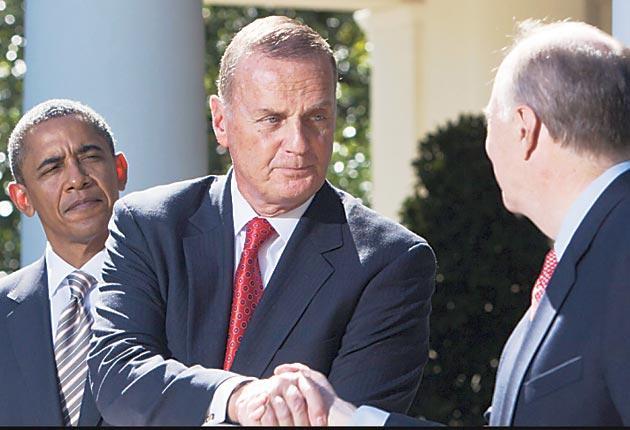 US National Security Adviser Jim Jones, centre, with his successor, Tom Donilon, and President Barack Obama