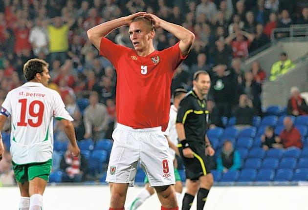 Wales forward Steve Morison reacts to a missed chance in Cardiff