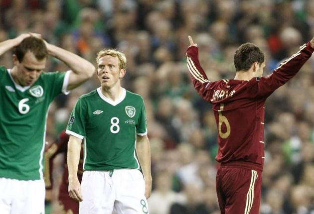 Republic of Ireland players Glenn Whelan (left) and Paul Green show their disappointment after Roman Shirkov's goal for Russia