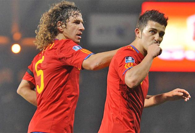 Carlos Puyol (left) congratulates David Villa after the Barcelona striker put the world champions ahead from the penalty spot