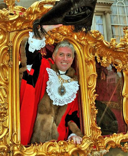 Nick Anstee waves to the crowds from his gilded coach during last year's Lord Mayor's Show
