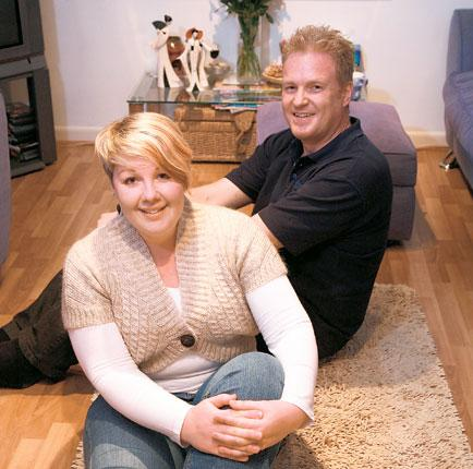 Every little helps: Helen Simpson with her lodger Richard Boyd in her Leamington Spa flat where they often eat dinner together