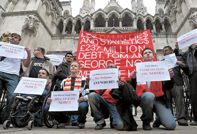 Liverpool fans make their feelings clear during a protest outside the High Court in London