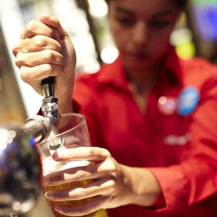 A pint is poured at a Wetherspoon's pub in London. A management shake-up triggered a 4 per cent fall in the group's share price