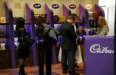 Visitors browse goods from chocolate retailer Cadbury at last year's TFWA exhibition
