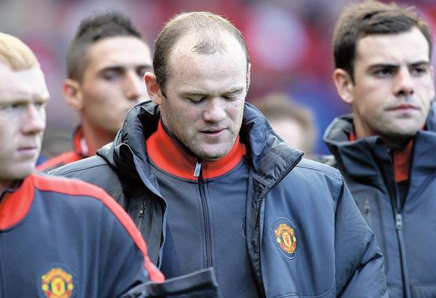 Rooney (centre) has been voicing concerns about his future at United since the World Cup
