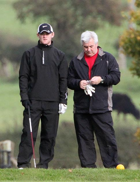 Rooney plays a round of golf with his agent Paul Stretford
