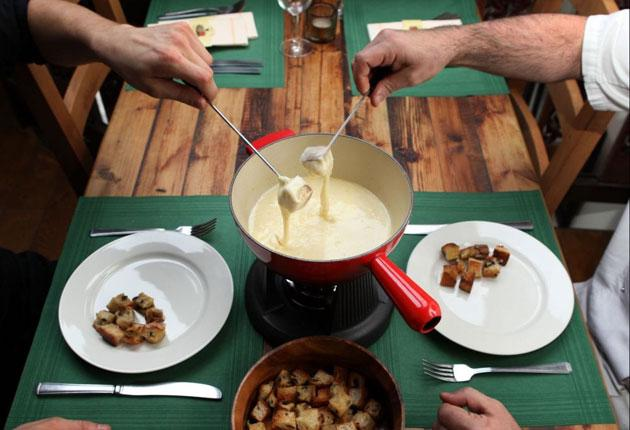 Dipping in: Fondue is seen as the most iconic of Seventies dishes, and sales of Gruyere and Emmental are booming