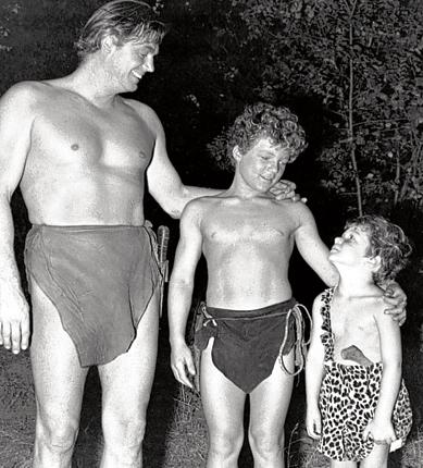 Sheffield, centre, with Weissmuller and his son Johnny, Jr in 1945
