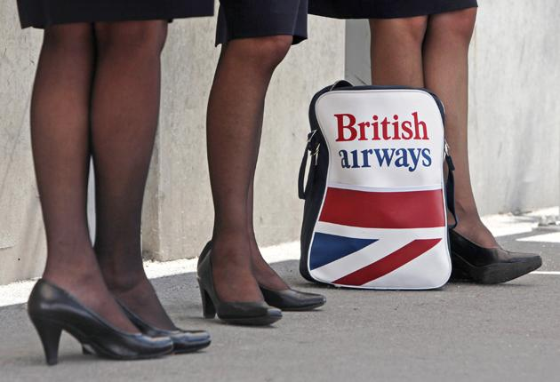 British Airways cabin crew wait outside Heathrow Airport. Their industrial action has cost the airline about £150m and resulted in 22 days of strikes so far this year