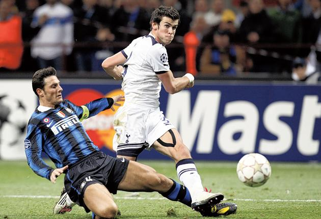 Gareth Bale scores one of his three goals against Internazionale at San Siro on Wednesday