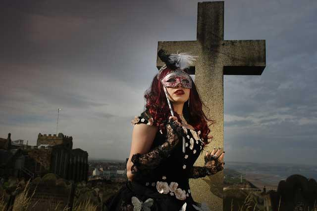 Cross purposes: a young goth braves the North Sea winds in a churchyard during Whitby's Gothic Weekend