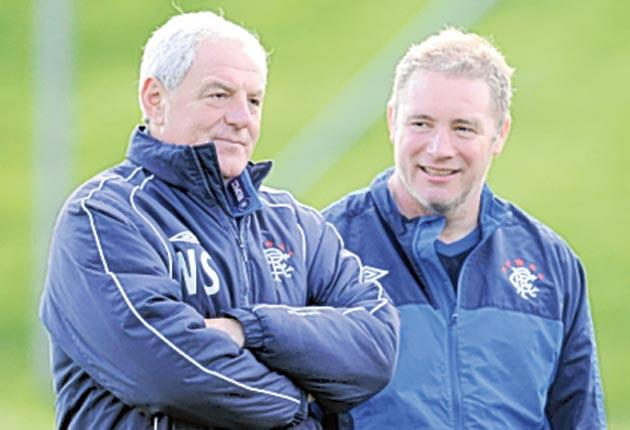 Walter Smith (left), in his final season as Rangers manager, watches training with assistant Ally McCoist