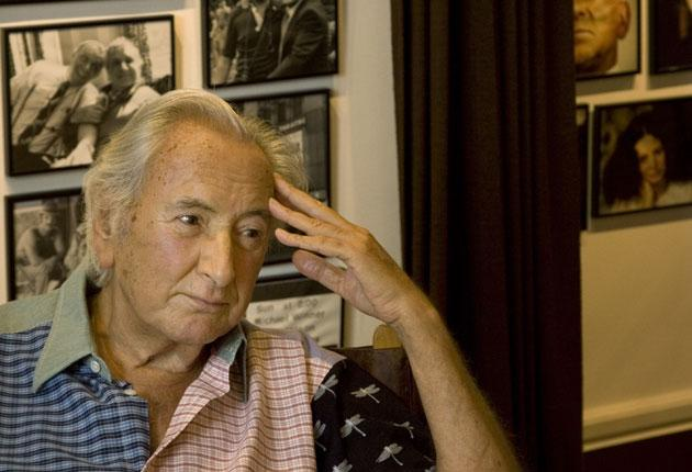 Michael Winner last week at his London Mansion where the walls drip with framed photos