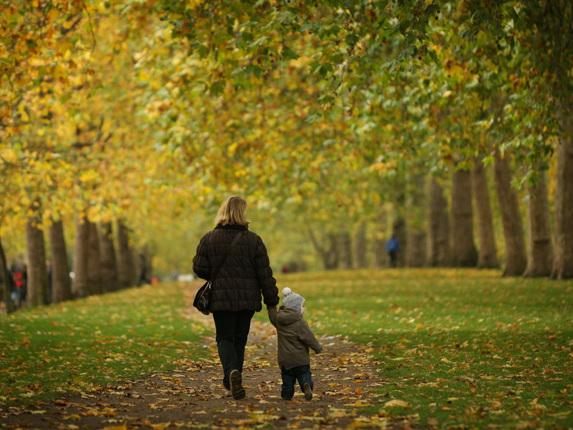 People walk through Autumn leaves in St James's Park yesterday