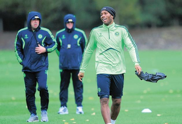 Didier Drogba laughs during a Chelsea training session ahead of their match against Spartak Moscow tonight