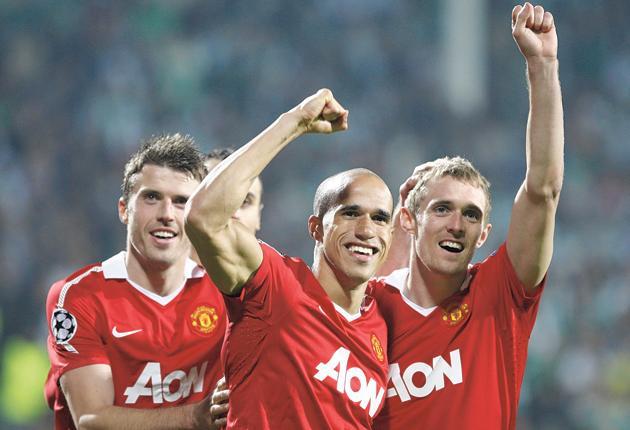 Michael Carrick celebrates Manchester United's victory over Bursaspor with team-mates Gabriel Obertan and Darren Fletcher