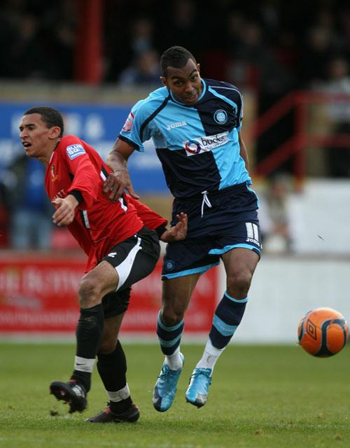 Nathan Webb (left) of Hayes & Yeading battles with Kevin Betsy of Wycombe, who won 2-1