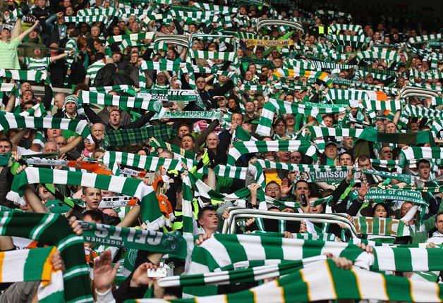 A section of supporters called the Green Brigade unfurled a banner during half-time of the 9-0 win over Aberdeen