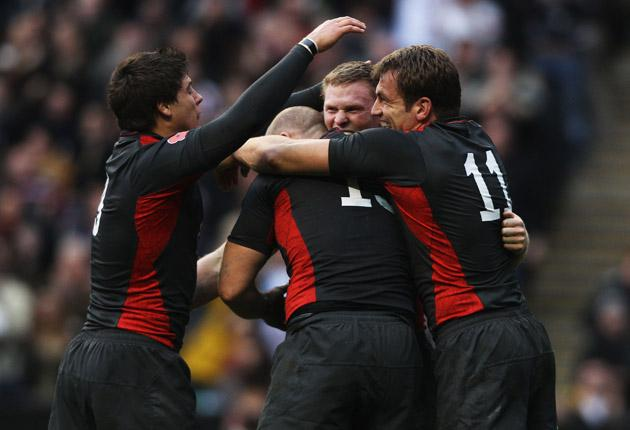 England players celebrate after Chris Ashton (2nd R) scored his team's second try during the Investec international test match between England and Australia at Twickenham