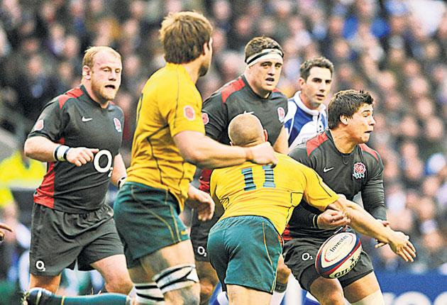 Ben Youngs (R) is tackled during the victory over Australia