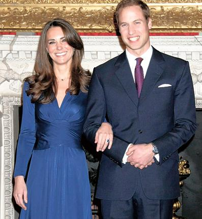William and Kate Middleton pose for photographs in the State Apartments of St James Palace