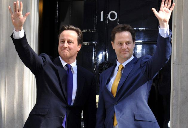 David Cameron and Nick Clegg put on a show of unity outside Downing Street