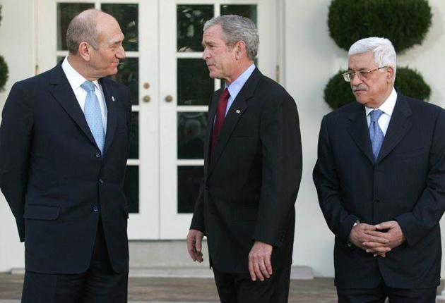 Ehud Olmert, left, with George Bush and Mahmoud Abbas in 2007. He believes he came closer to peace with the Palestinians than any other Israeli leader