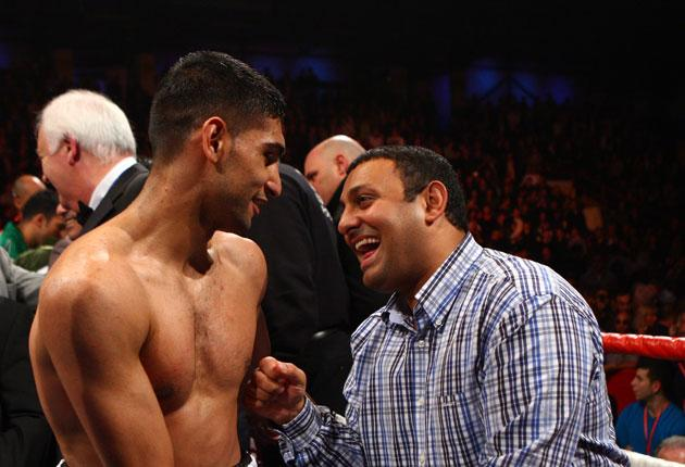 Naseem Hamed (right) shares a joke with Amir Khan. He says: 'Boxing has lost its glamour and excitement. I'm going to bring it back'