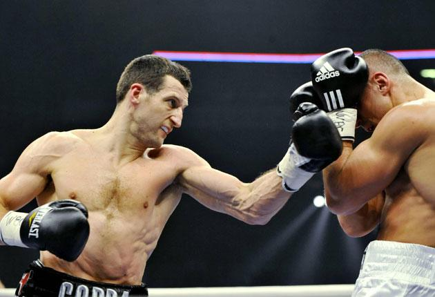Karl Froch was in imperious form as he brushed aside Arthur Abraham to regain his world title
