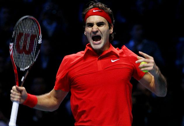 Roger Federer celebrates victory over Rafael Nadal in last night's decider at the ATP World Tour Finals