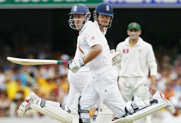 Andrew Strauss (left) and Alastair Cook put on 188 for England's first wicket against Australia at The Gabba