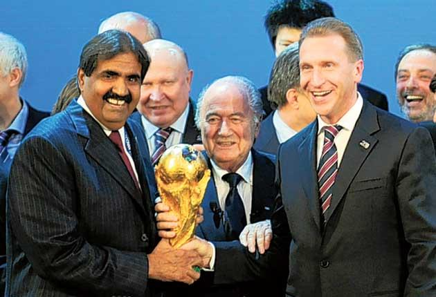 The Emir of Qatar, Sheikh Hamad bin Khalifa Al-Thani (left), with the Fifa president, Sepp Blatter, and Russia's Deputy Prime Minister, Igor Shuvalov