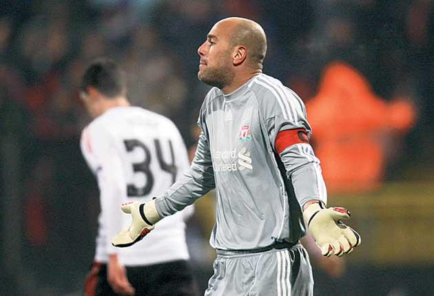 Liverpool goalkeeper Pepe Reina tries to apologise after letting Eder Bonfim's soft header through his legs for Steaua Bucharest's equaliser