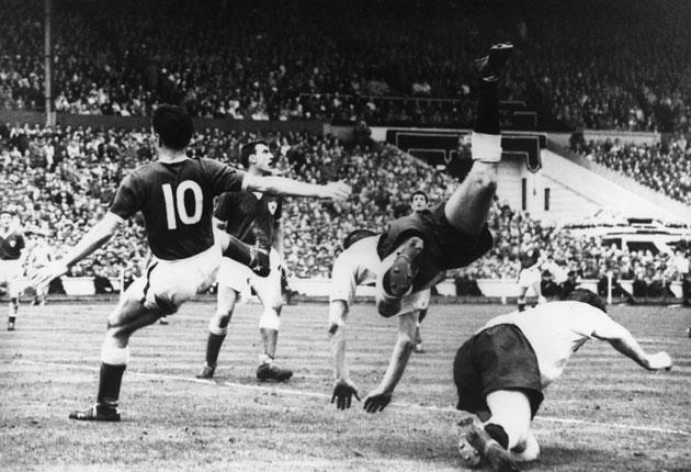 Cliff Jones (centre) takes a tumble in the 1961 FA Cup final against Leicester City that secured the Double
