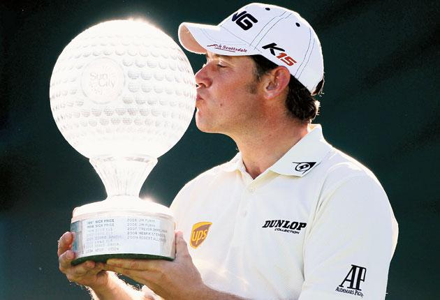 Lee Westwood strolled to an eight-stroke victory in South Africa