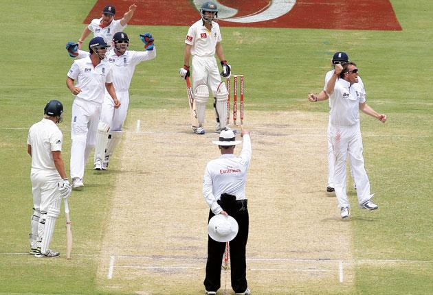 Graeme Swann and the England players celebrate his classic off-spinner's dismissal of the Australia opener Simon Katich